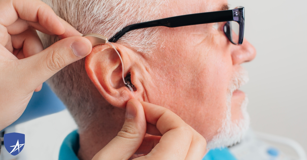 senior man being fitted for hearing aids