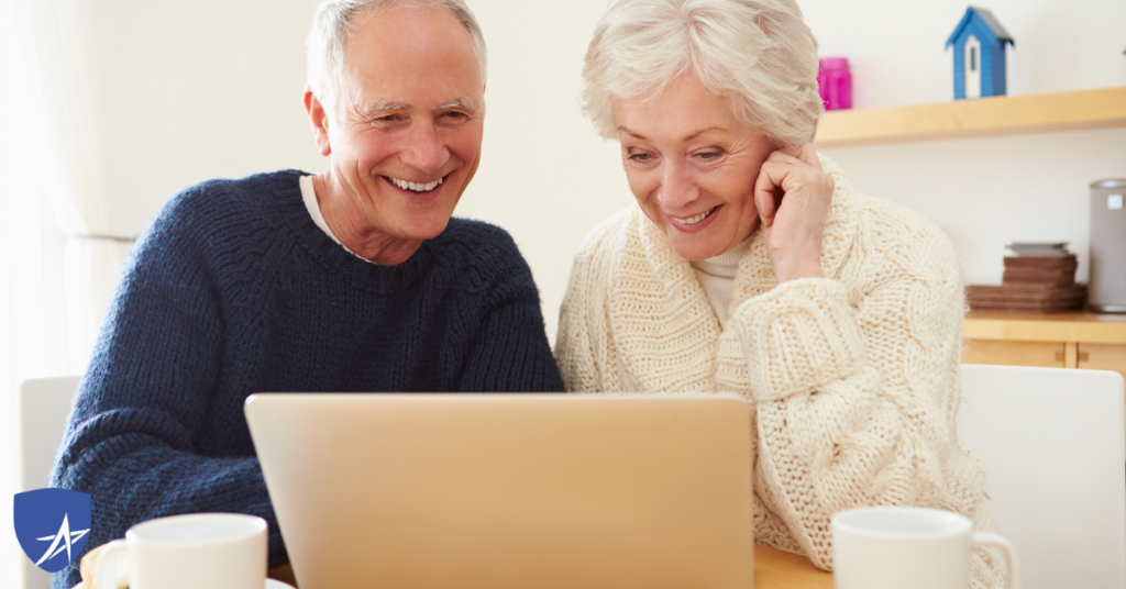 senior couple smiling at computer